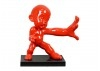 Statue of a baby ninja in red color