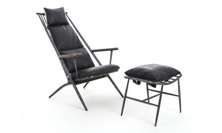 Fauteuil incliné et repose pied en cuir noir vintage