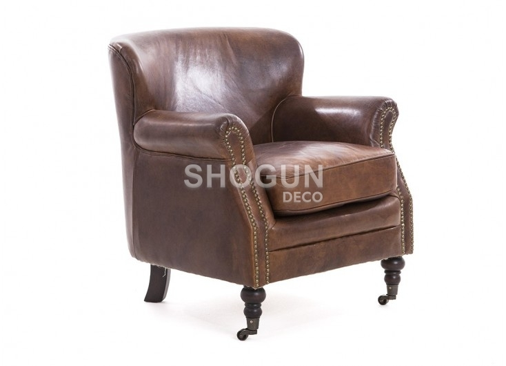 Club armchair in brown aged leather