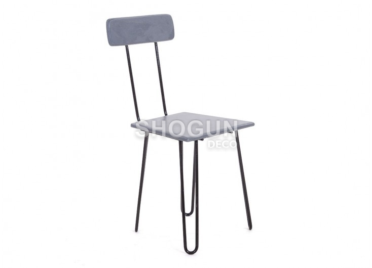 Chaise en ciment et pieds en épingle