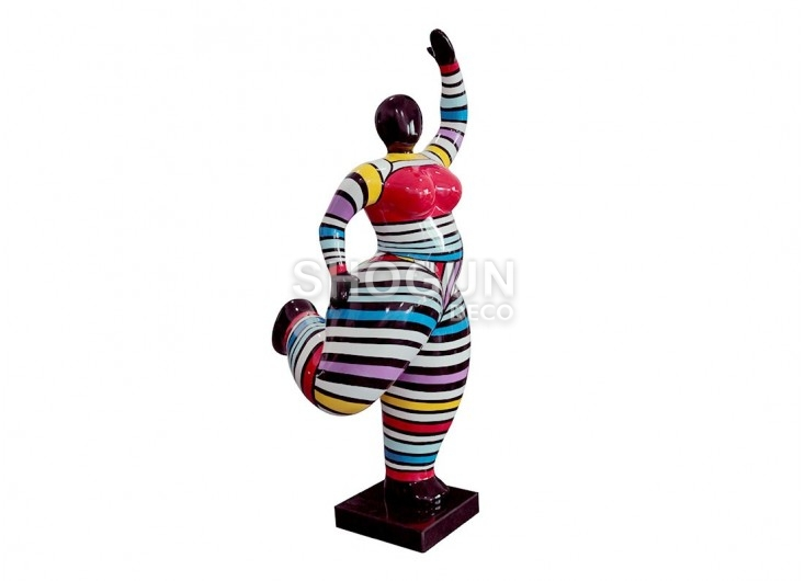 Statue of big woman with stripped outfit