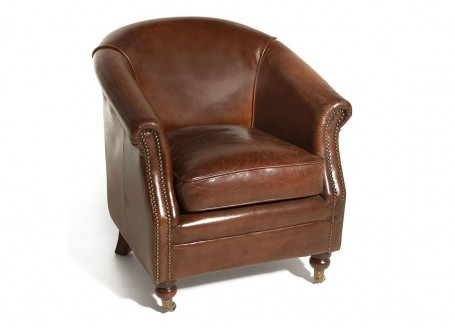Club armchair in brown leather