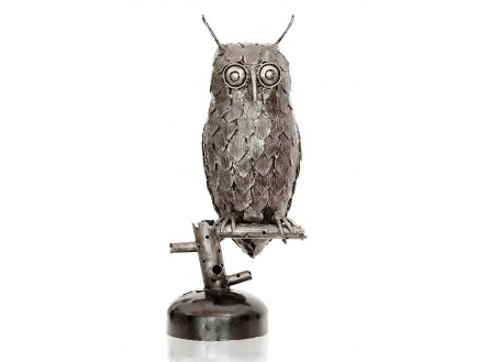 Owl statue made out of mechanical pieces