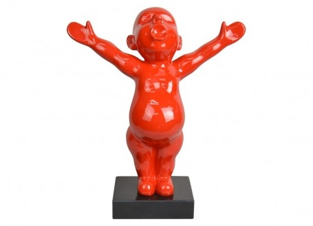Statue of a red baby in resin